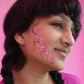 Face painting at Cancer Research event